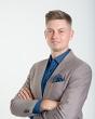 Pośrednik Grzegorz Kozłowski pracujący w biurze nieruchomości: PÓŁNOC Nieruchomości
