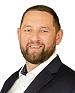 Pośrednik Grzegorz Zębala pracujący w biurze nieruchomości: Agencja Bracia Sadurscy