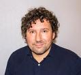 Pośrednik Robert Tomczak pracujący w biurze nieruchomości: 'DOM Nieruchomości'