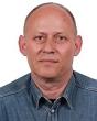 Pośrednik Zbigniew Pisarski pracujący w biurze nieruchomości: Agencja Bracia Sadurscy