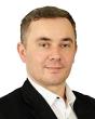 Pośrednik Piotr Dziadzio pracujący w biurze nieruchomości: Bracia Sadurscy Nieruchomości